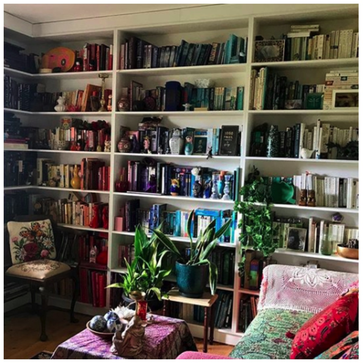 Color organized bookshelf in home