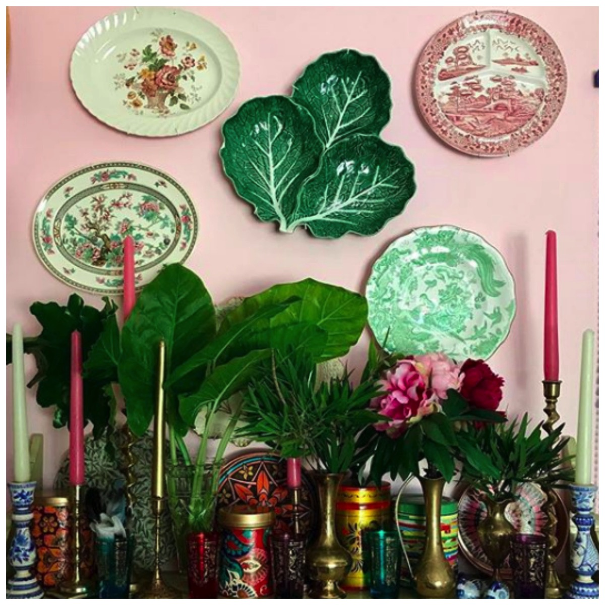 Pink boho home with plates and plants