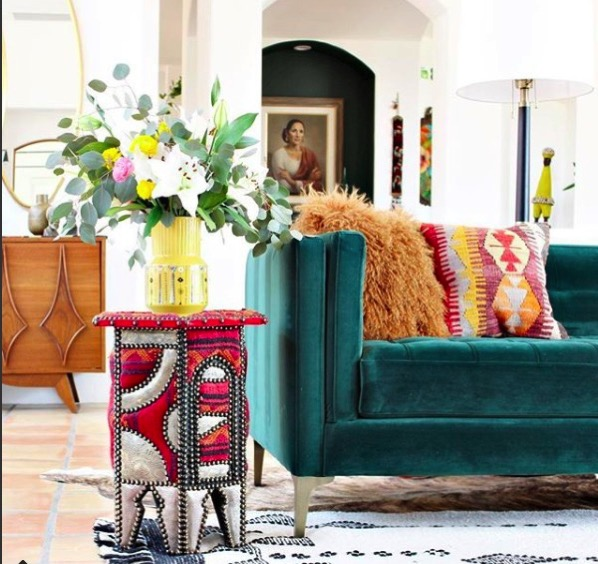 Teal colored bright sofa couch with accent table