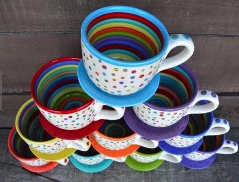 Rainbow colored coffee cups on etsy in a glaze